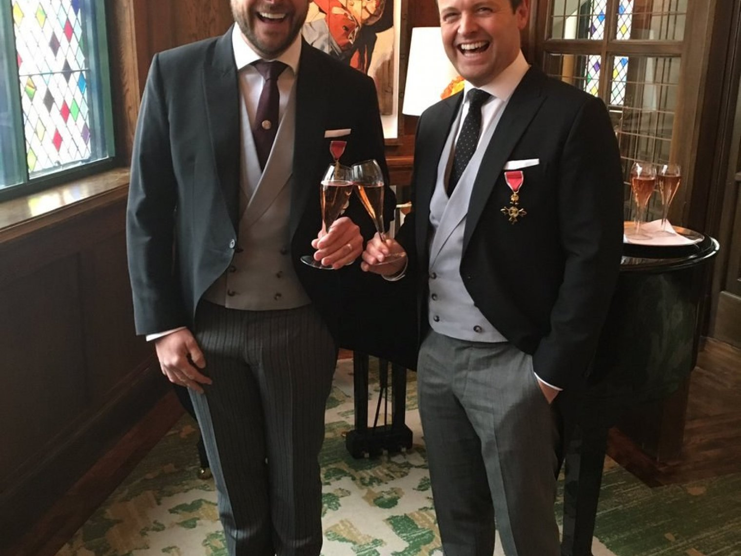 'Chuffed to bits!' Ant & Dec collect their OBEs